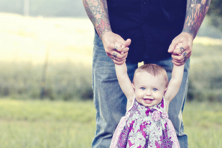 toddler and her family portrait by photographer Becca Bond