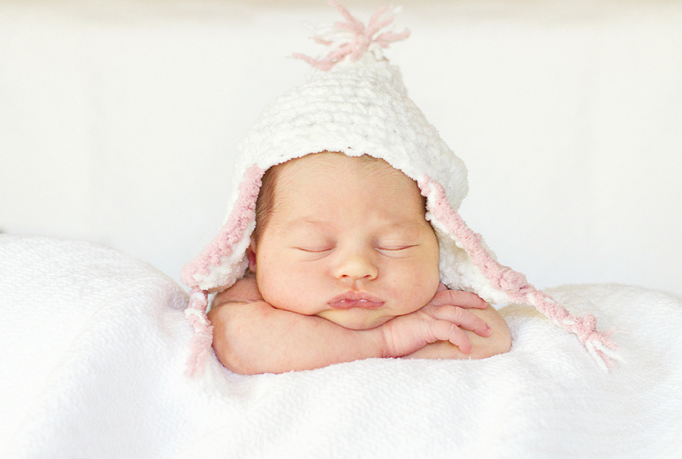 Newborn baby by Charlotte photographer