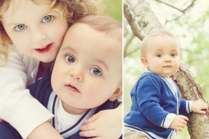Child hugs baby brother in family photo