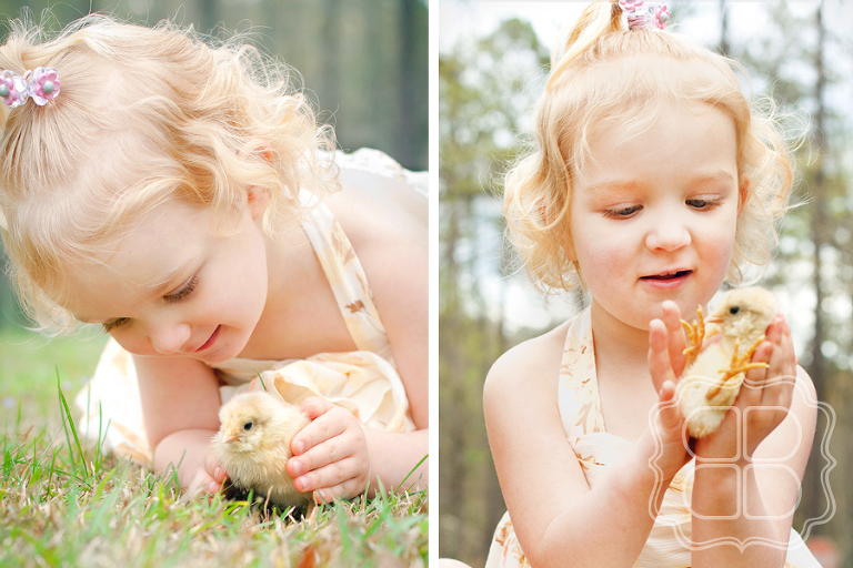 Child holding baby chick