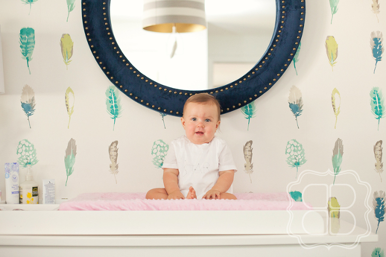 Baby with boho feather wallpaper