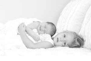 Charlotte newborn with sister