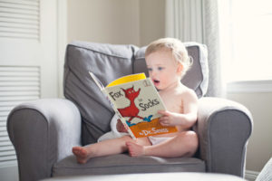 Toddler reading Dr Seus