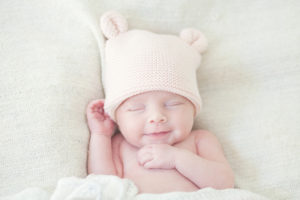 Baby smiles in crochet hat with ears