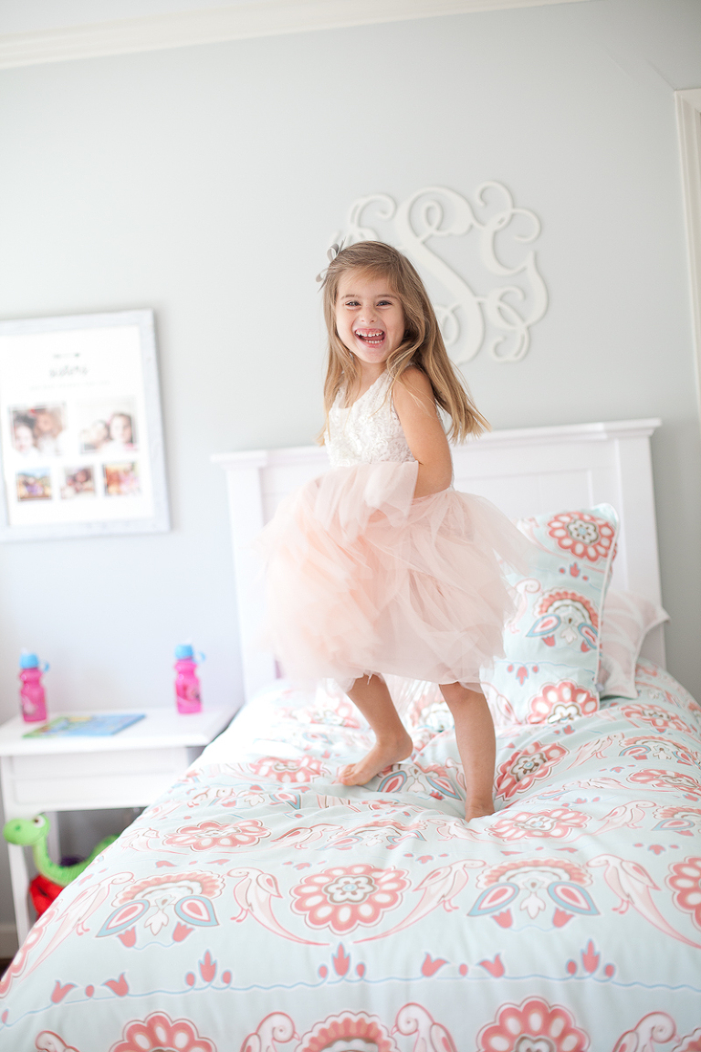 Child in tulle skirt on bed