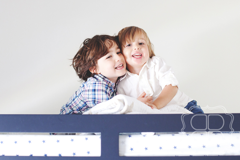 Fun portrait of two boys in bunkbed.
