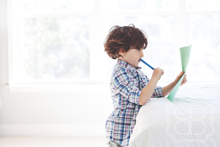 Child works on drawing for parents
