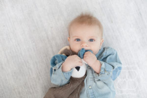 Baby boy with teether toy ram