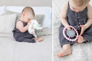 Shy baby girl with toy