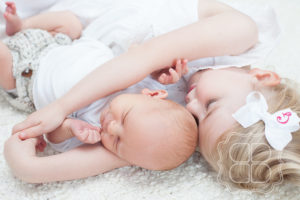 Lifestyle Portrait of baby and and sister
