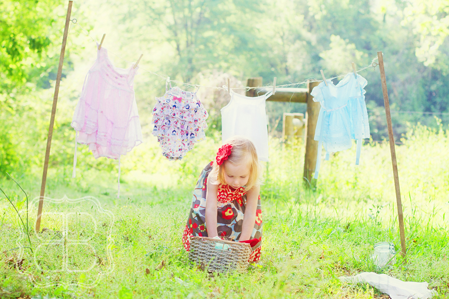 Charlotte children's photographer picture of a little girl doing laundry