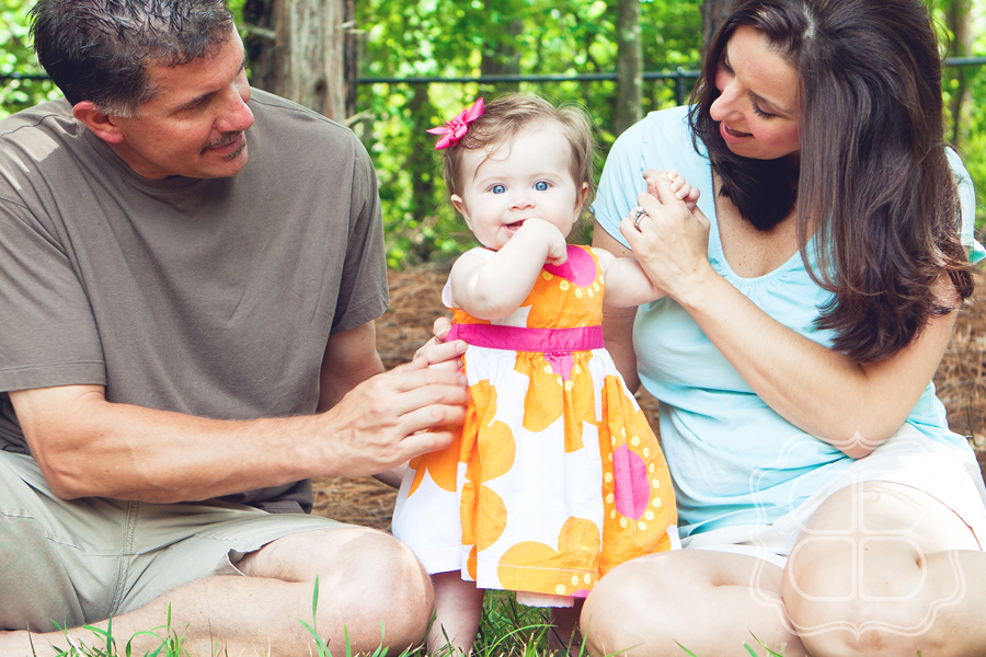 Outdoor photo taken in Charlotte of a family and their baby girl